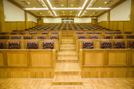 Conference halls with magnificent leather armchairs and wooden tables with microphones, Wide angle Stock Photo - 11728426