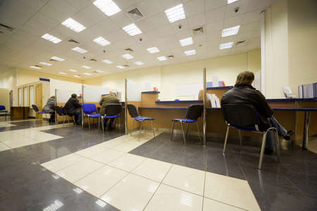 Bank office, Servicing branch, Cabins of operators, Clients of bank Stock Photo - 11728418