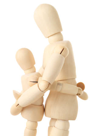 wooden mannequin: wooden figures of parent embracing his child, half body, side view, isolated on white