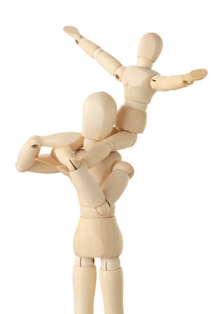wooden mannequin: wooden figures of child sitting on neck of his parent and putting hand up, half body, isolated on white Stock Photo