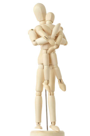 wooden doll: wooden figures of parent carring his child from back, full body, isolated on white
