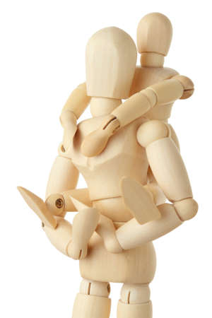 wooden figures of child sitting on back of his parent and embracing him, half body, isolated on white photo