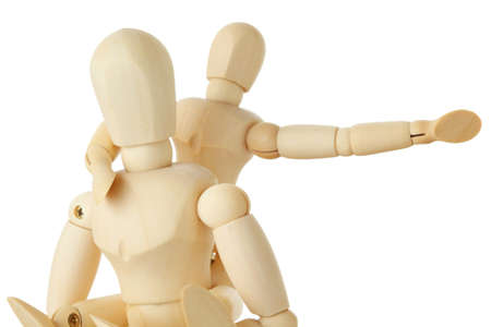 wooden doll: wooden figures of child sitting on back of his parent and pointing for one hand right, half body, isolated on white