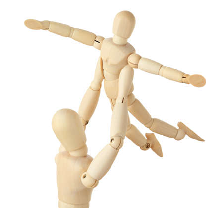 wooden figures of parent carring his child over his head, child aparting hands, half body, square format, isolated on white photo