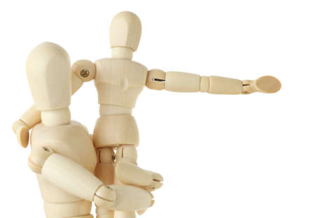 wooden mannequin: wooden figures of child sitting on hands of his parent and pointing for hand at right, half body, isolated on white