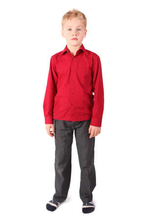 red pants: one young boy wearing red shirt and brown pants standing alone. isolated. Stock Photo