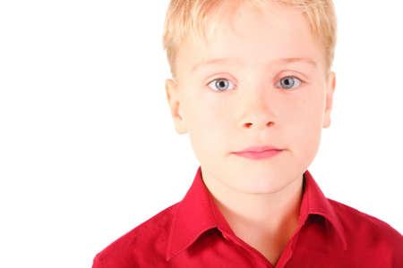 portrait of sadness boy with melancholy eyes. boy wearing shirt. isolated. Stock Photo - 12130422