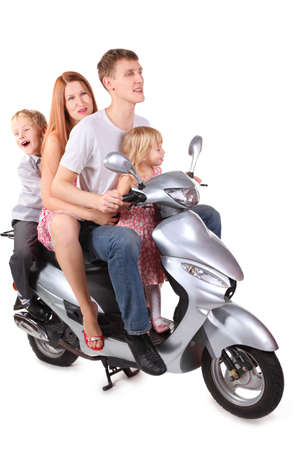 Father, mother and two children is sitting on motorcycle. Isolated. Focus on father's right leg. Stock Photo - 12130635