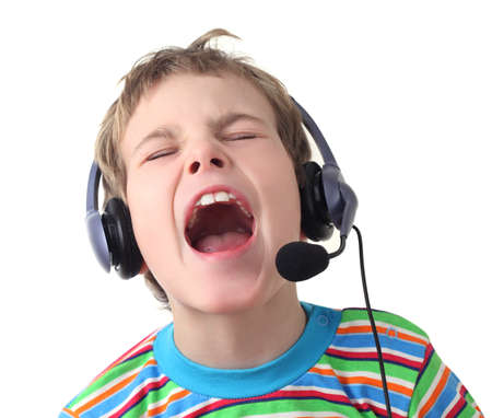 Children cry: portrait of little boy with headphones and microphone singing with closed eyes, isolated on white Kho ảnh