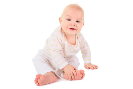 all smiles: joyful smiling baby boy is sitting and looking at camera. isolated.