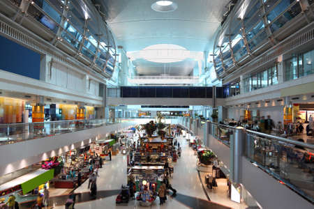 DUBAI - APRIL 19: big modern shopping center in Dubai International Airport on April 19, 2010 in Dubai, UAE. The maximum throughput of the airport is 80 million passengers in a year. Stock Photo - 11728388