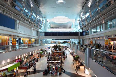 bright center: DUBAI - APRIL 19: big modern shopping center in Dubai International Airport on April 19, 2010 in Dubai, UAE. The maximum throughput of the airport is 80 million passengers in a year. Editorial