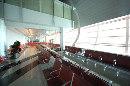throughput: DUBAI - APRIL 19: interior of Dubai International Airport on April 19, 2010 in Dubai, UAE. The maximum throughput of the airport is 80 million passengers in a year Editorial