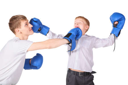 father and his son is boxing with boxing gloves. father is giving a slap to boy's face. Stock Photo - 12130515
