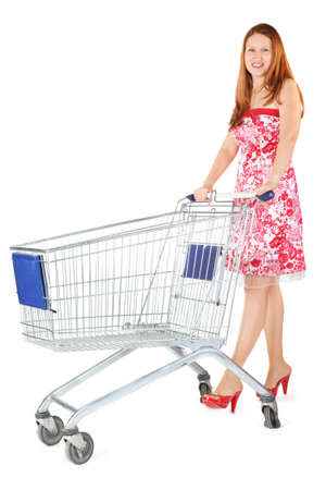 hand baskets: joyful woman wearing dress is standing with shopping basket. isolated.