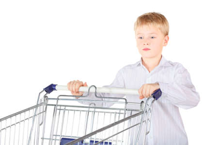 sadness boy is standing near shopping basket and looking away. focus on boy's face. isolated. Stock Photo - 12130420