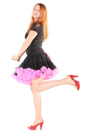 attractive joyful woman wearing dress and shoes is posing. isolated. Stock Photo - 12130324