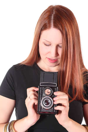 attractive woman wearing shirt is holding old photocamera. isolated. Stock Photo - 12130870