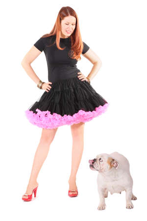 beautiful woman wearing dress is looking at english bulldog. isolated. Stock Photo - 12130318