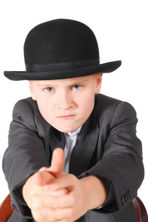 handsome little boy wearing suit and hat is playing gangster. isolated. photo
