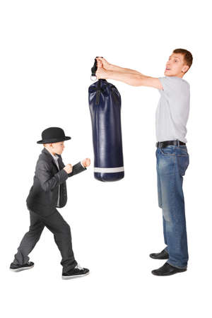 father and little boy wearing gangster suit. father is holding punching bag. photo