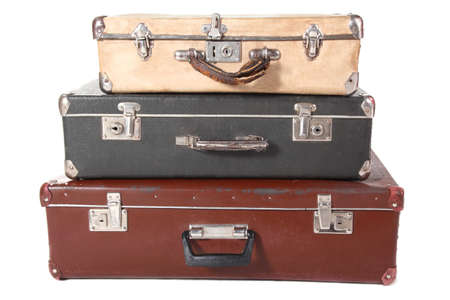dusty: three old dirty dusty suitcases. all suitcases is closed. Isolated.