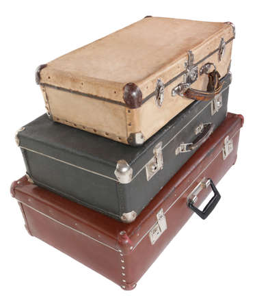 bight: three old dirty dusty suitcases. all suitcases is closed. Isolated. focus on front corner of black suitcase. Stock Photo