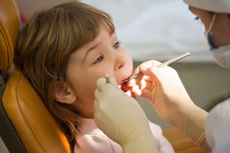 stomatologist: young girl have periodic survey tooth in medical office