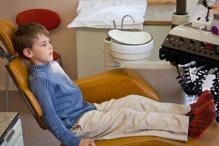 stomatological: young boy wait medical worker in armchair stomatological office  Stock Photo
