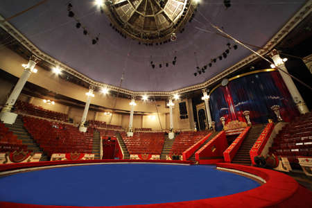 celling: blue circle arena in circus white lamps turned on, general view on celling Editorial