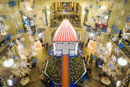 festoons: New year in Moscow. GUM trading house. Modern shopping center interior. Editorial