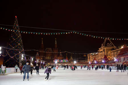 rink: skating-rink on red square in moscow at night. GUM trading house. Forshortening with side Editorial