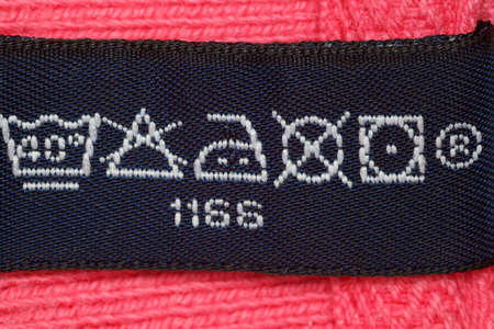 look after: Symbols on label clothes showing as it is necessary to look after these clothes. Close up.