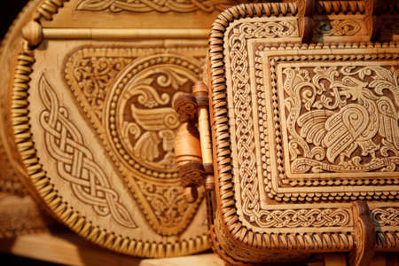 souvenir traditional: Beautiful boxes made of birch bark with  carved pattern. Russian national crafts. Focus on the lid. Editorial