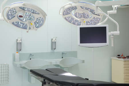surgery table: Equipment for the operating room. Special lamps, monitor and desk.