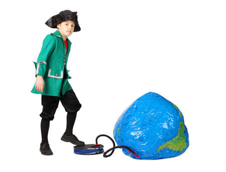 columb: little boy in historical dress pumping inflatable globe isolated