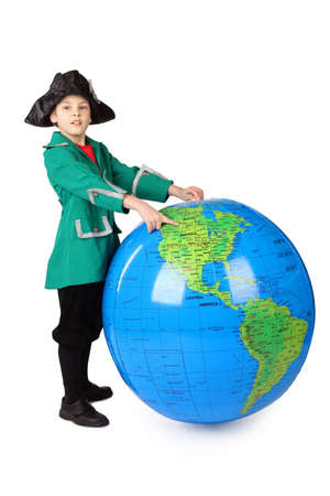 columb: little boy in historical dress standing with big inflatable globe and pointing by finger