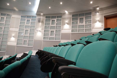 Interior of hall for conferences. Rows of chairs for spectators.
