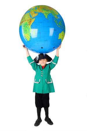 columb: little boy in historical dress holding big inflatable globe over his head isolated