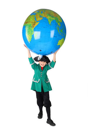 role model: little boy in historical dress with opened mouth holding big inflatable globe over his head isolated