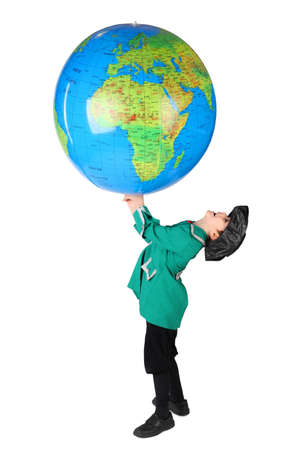 columb: little boy in historical dress holding big inflatable globe over his head  side view isolated