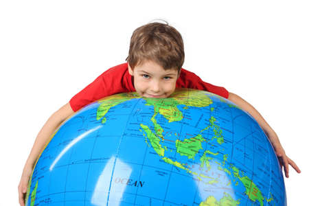 boy in red shirt lies on inflatable globe isolated on white background Stock Photo - 12614094