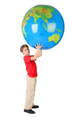 boy in red shirt holding big inflatable globe over his head side view isolated Stock Photo - 12608423