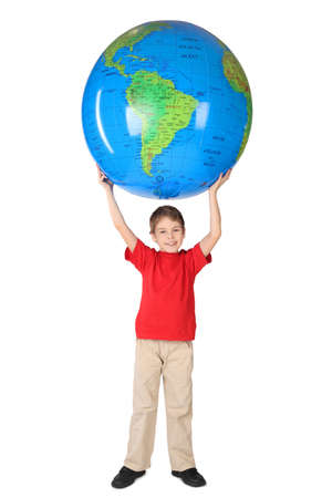boy in red shirt smiling and holding big inflatable globe over his head isolated Stock Photo - 12608421