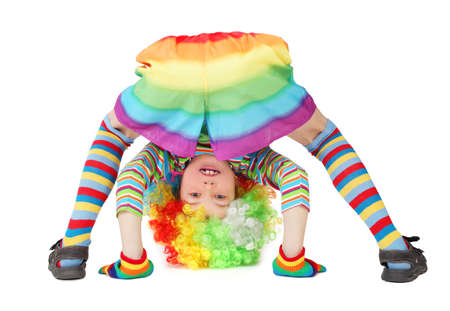 little boy in clown dress somersault isolated on white photo