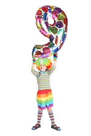 boy in clown dress with balloon shape nine over his head isolated on white background Stock Photo - 12612525
