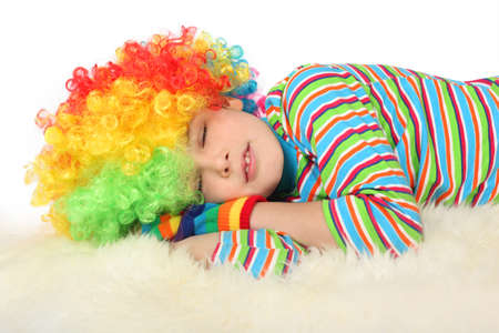 boy in clown dress sleeping isolated on white background Stock Photo - 12614241