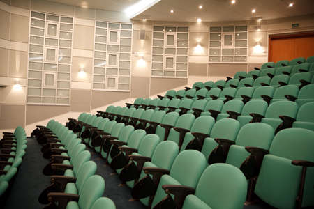 lecture room: Interior of hall for conferences. Rows of chairs for spectators.
