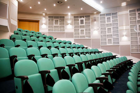 lecture room: empty conference hall, rows of a chairs, eight numbers in shot Editorial