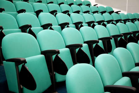 Fragment of empty conference hall, rows of a chairs